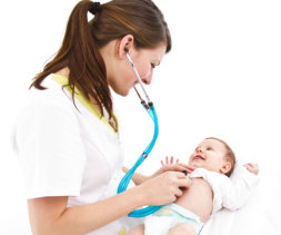 nurse checking the baby